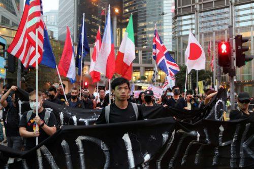 Người Hong Kong biểu tình kêu gọi quốc tế gây sức ép lên Trung Quốc - Ảnh 1.