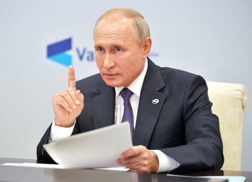 Ông Putin: Mỹ, Nga đã hết thời, Trung Quốc sẽ làm anh cả của thế giới - Ảnh 1.