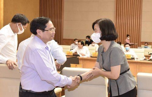 Thủ tướng Phạm Minh Chính và bà Vũ Việt Trang, Phó Tổng Giám đốc TTXVN. (Ảnh: Dương Giang/TTXVN)